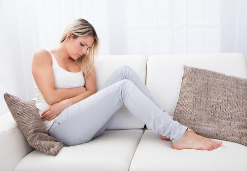 Вздутие и боль внизу живота у женщин и мужчин